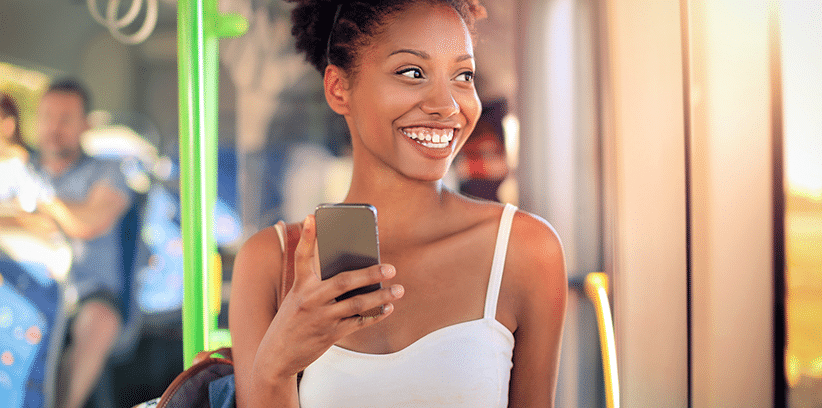 happy woman chatting with someone through smartphone