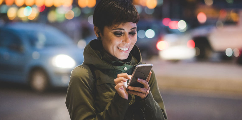 happy woman using online dating app